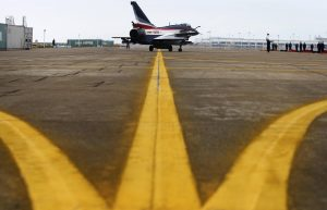 J-10 fighter jet from the August 1st Aerobatics Team of the People's Liberation Army Air Force is seen on the tarmac after landing as it arrives for the upcoming China International Aviation & Aerospace Exhibition, in Zhuhai, Guangdong province, November 5, 2014. The exhibition will be held in the southern Chinese city of Zhuhai of Guangdong province from November 11 to 16. Picture taken November 5, 2014. REUTERS/Stringer (CHINA - Tags: TRANSPORT MILITARY) CHINA OUT. NO COMMERCIAL OR EDITORIAL SALES IN CHINA - RTR4D27S