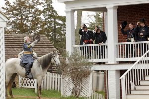 Period-costumed actor of General Robert E. Lee leaves after the surrender during the 150th anniversary re-enactment of the surrender of General Robert E. Lee to General Ulysses S. Grant at the Court House National Historic Park in Appomattox, Virginia,  April 9, 2015.    REUTERS/Jay Paul