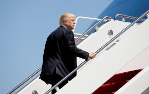 President Donald Trump boards Air Force One upon his departure from Joint Base Andrews in Maryland. Photo by Kevin Lamarque/Reuters