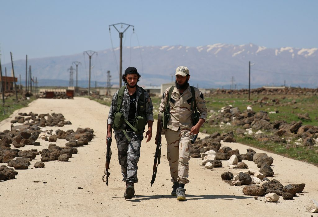 Free Syrian Army fighters walk in the northern province of Quneitra, Syria, on April 18. Photo by Alaa Al-Faqir/Reuters