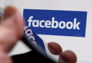File photo of Facebook logo by Regis Duvignau/Reuters
