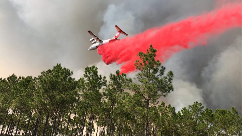 An airplane drops fire retardent as the West Mims fire burns in the Okefenokee National Wildlife Refuge in a photo released in Folkston, Georgia, on April 29, 2017. Photo by U.S. Fish and Wildlife Service via Reuters