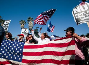 Protesters gather at McArthur Park for the May Day protest march in Los Angeles, California, U.S. May 1, 2017. REUTERS/Kyle Grillot - RTS14OLW