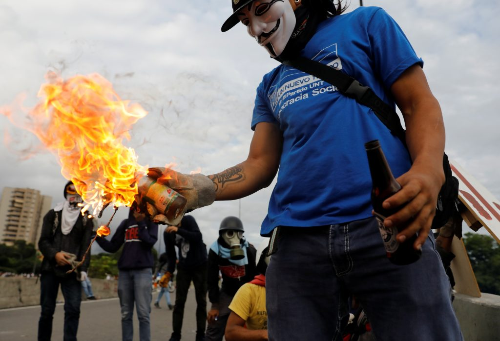 The protests also included store looting. Photo by Carlos Garcia Rawlins/Reuters