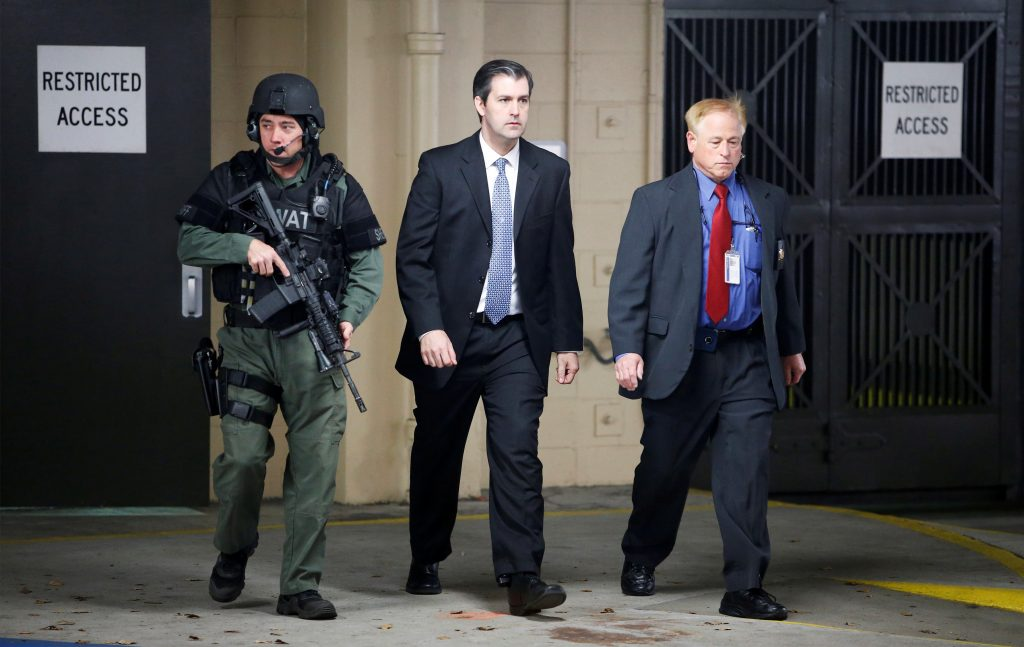 Former North Charleston police officer Michael Slager is escorted from the courthouse by security personnel while waiting on his verdict at the Charleston County Courthouse in Charleston, South Carolina, in December 2016. Photo by Randall Hill/Reuters