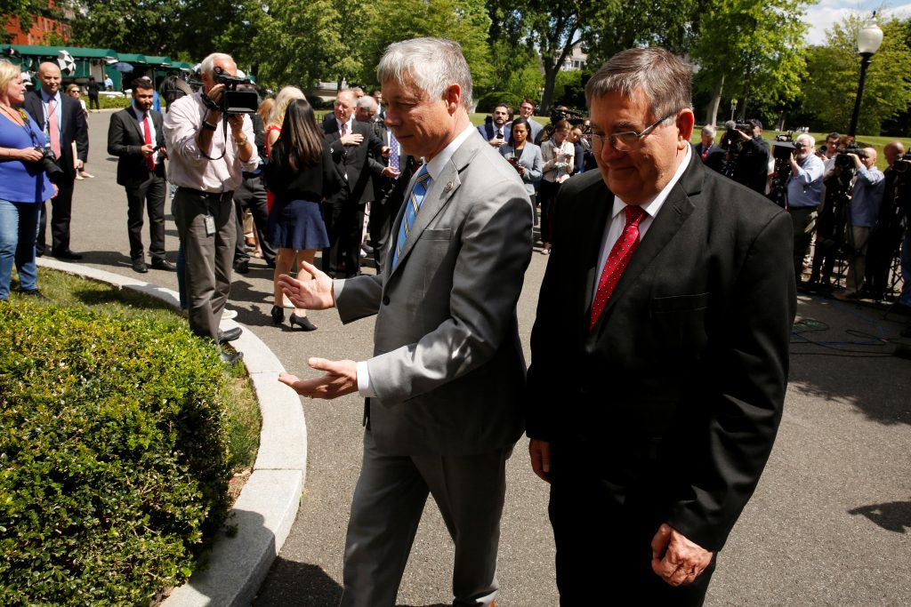 Reps. Fred Upton (R-MI) (C) and Michael Burgess (R-TX) (R) return to the West Wing after speaking to reporters about health care legislation after meeting with President Donald Trump. Photo by Jonathan Ernst/Reuters