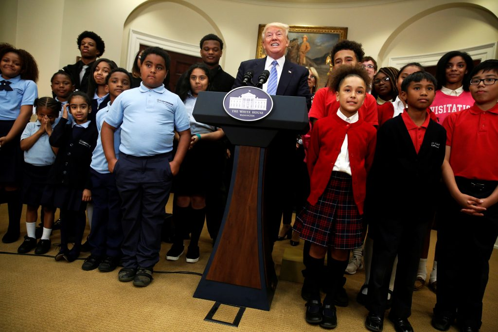 President Donald Trump (C) speaks to students at a school choice event at the White House in Washington, D.C. Photo by Jonathan Ernst/Reuters