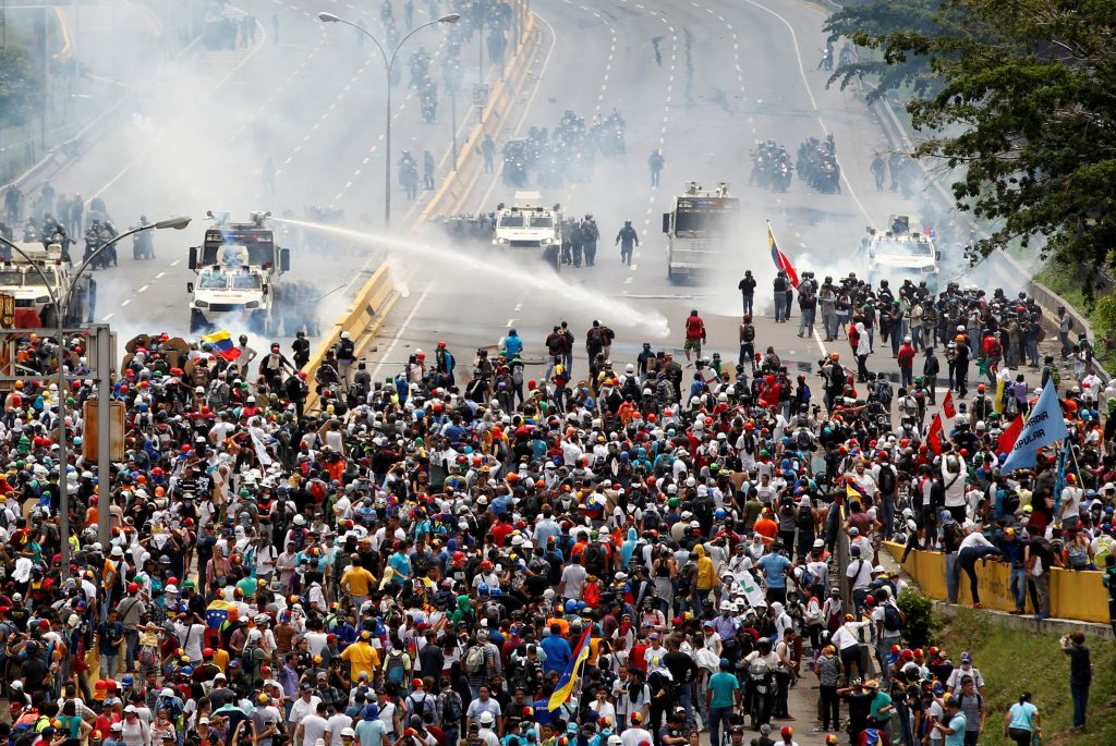 An estimated 37 people have been killed in the street protests. Photo by Christian Veron/Reuters