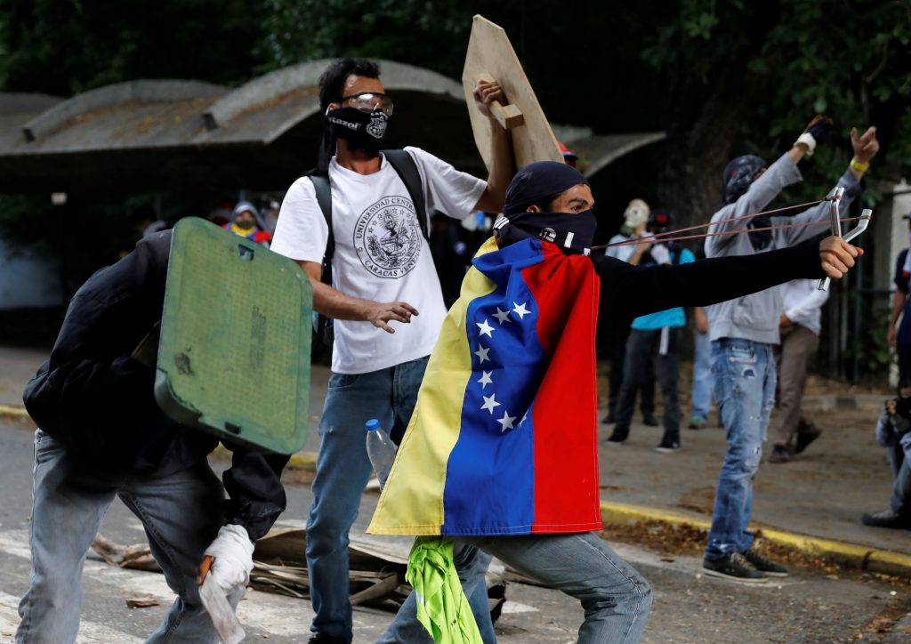 Students joined in the protests in Caracas on May 4. Photo by Carlos Garcia Rawlins/Reuters
