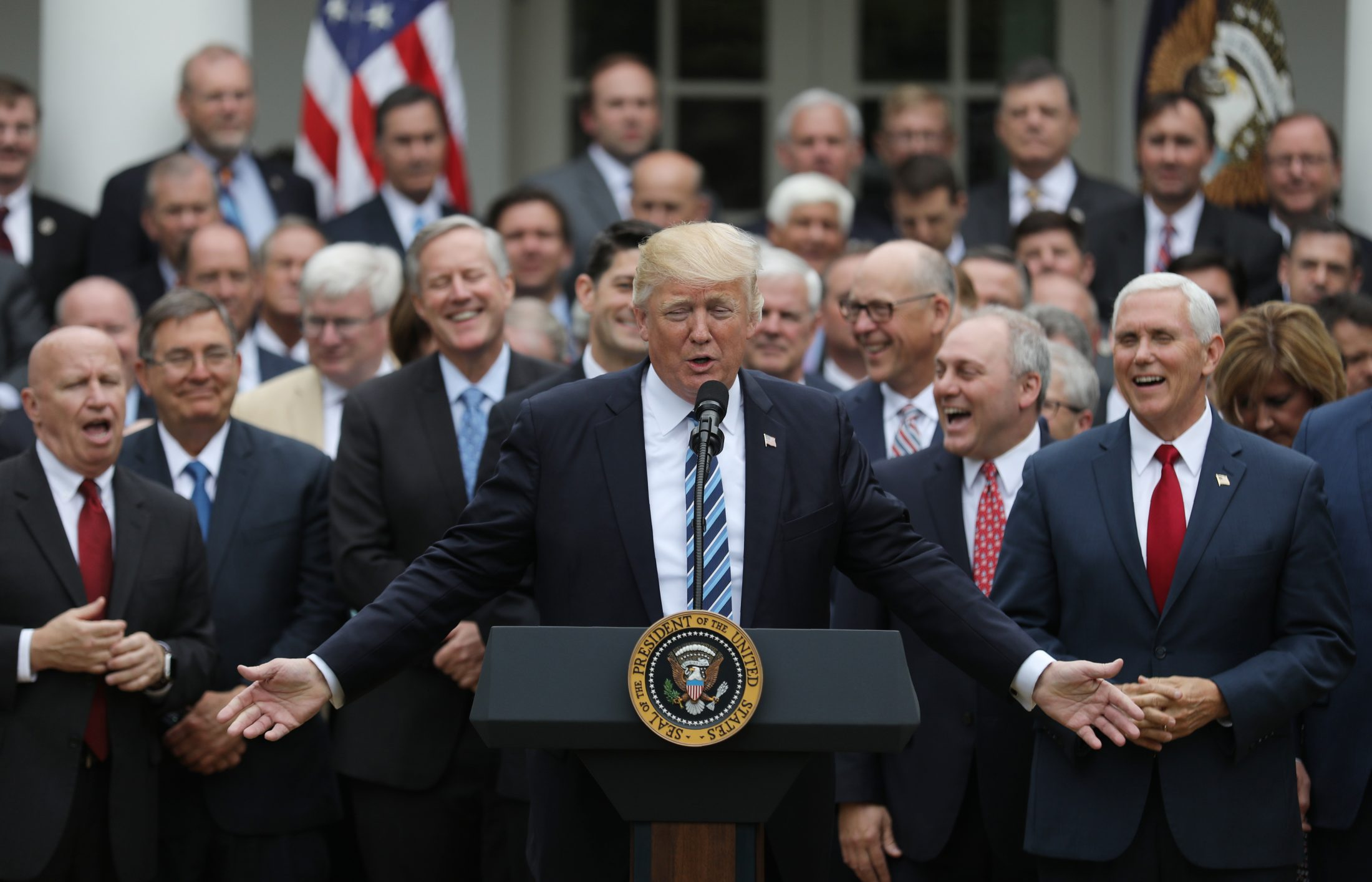 President Donald Trump (C) gathers with Vice President Mike Pence (R) and Congressional Republicans in the Rose Garden of the White House after the House of Representatives approved the American Healthcare Act, to repeal major parts of Obamacare and replace it with the Republican healthcare plan, in Washington, D.C. Photo by Carlos Barria/Reuters