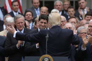 U.S. President Donald Trump (C) turns to House Speaker Paul Ryan (3rdL) as he gathers with Congressional Republicans in the Rose Garden of the White House after the House of Representatives approved the American Healthcare Act, to repeal major parts of Obamacare and replace it with the Republican healthcare plan, in Washington, U.S., May 4, 2017. Photo by Carlos Barria/REUTERS