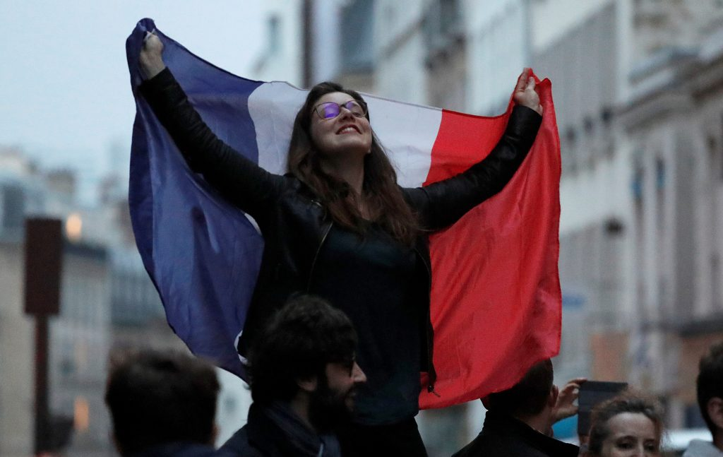 A supporter of President Elect Emmanuel Macron celebrates in Paris