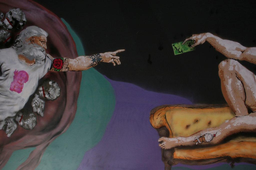 "A reinterpreted version of Michelangelo's ""Creation of Adam"" is pictured on a ceiling inside the newly opened Kitsch Museum. Photo by Octav Ganea/Inquam Photos via Reuters"
