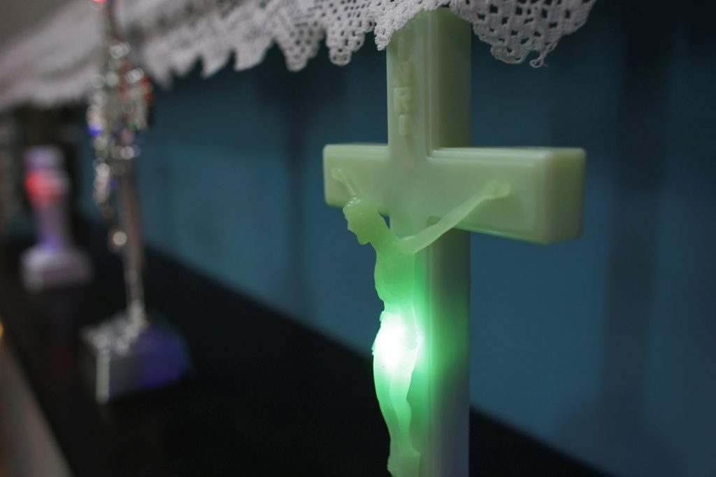 An LED light shines within a plastic crucifix. Photo by Octav Ganea/Inquam Photos via Reuters