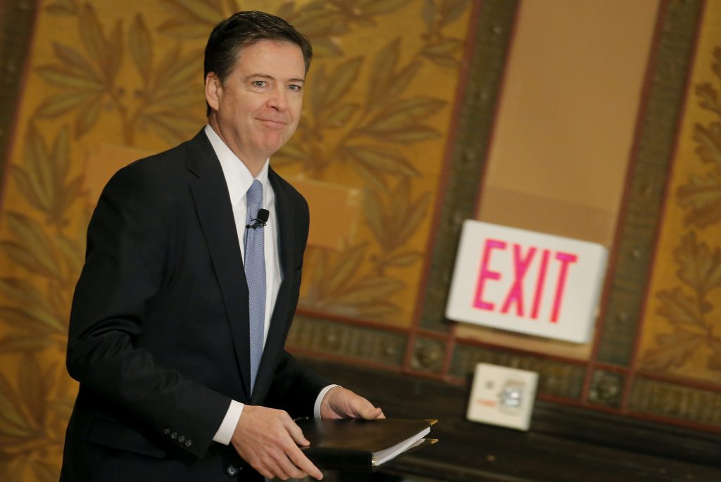 FILE PHOTO: FBI Director James Comey arrives to deliver a speech at the Master of Science in Foreign Service CyberProject's sixth annual conference at Georgetown University in Washington D.C., U.S. April 26, 2016. REUTERS/Carlos Barria/File Photo TPX IMAGES OF THE DAY - RTS15WVS