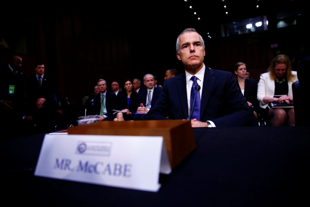 Acting FBI Director Andrew McCabe waits to testify before the Senate Select Committee on Intelligence on Capitol Hill in W...