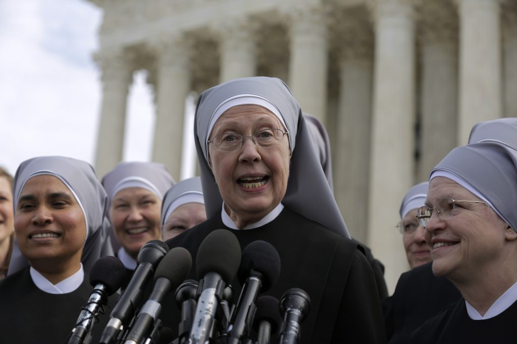 Sister Loraine McGuire with Little Sisters of the Poor speaks to the media after Zubik v. Burwell, an appeal brought by Christian groups demanding full exemption from the requirement to provide insurance covering contraception under the Affordable Care Act, was heard by the U.S. Supreme Court in Washington March 23, 2016. REUTERS/Joshua Roberts