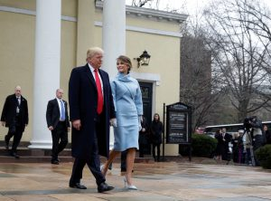 President-elect Donald Trump and his wife Melania depart from services at St. John's Church during his inauguration in Washington, U.S., January 20, 2017. REUTERS/Joshua Roberts - RTSWH0R