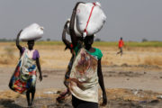 Women carry sacks of food in Nimini village, Unity State, northern South Sudan, February 8, 2017. Picture taken on February 8, 2017. REUTERS/Siegfried Modola - RTSZG0E