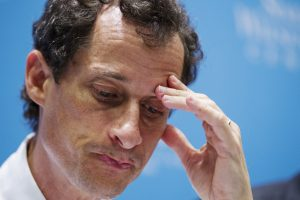 Anthony Weiner, a former U.S. congressman from New York, listens to fellow candidates speak at a 2013 debate in New York. Photo by Lucas Jackson/Reuters
