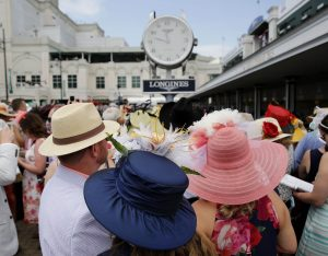 May 7, 2016; Louisville, KY, USA; Patrons stand in the paddock area as they wear derby hats before the 142nd running of the Kentucky Derby at Churchill Downs. Mandatory Credit: Mark Zerof-USA TODAY Sports - RTX2D9CJ