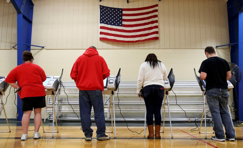 Voters cast their votes during the U.S. presidential election in Elyria, Ohio, U.S. November 8, 2016. REUTERS/Aaron Josefczyk/File Photo - RTX2T3ES