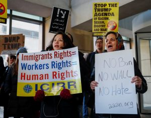 Demonstrators protest against President Donald Trump's revised travel ban in Chicago