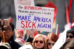 Activists protest against the Republican plan to repeal Obamacare during a rally in Freedom Plaza in Washington March 23, 2017. REUTERS/Kevin Lamarque - RTX32F4B
