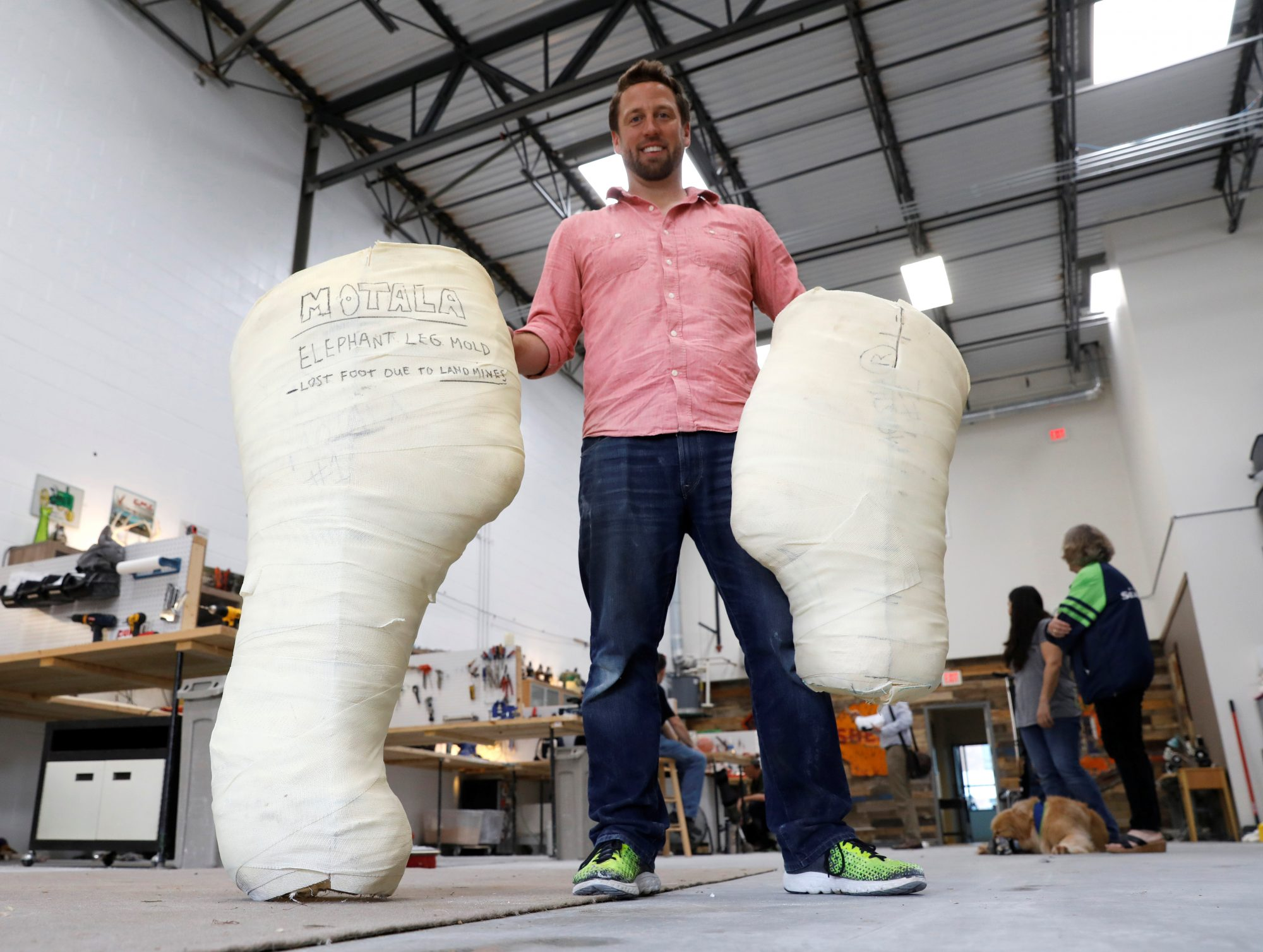 Derrick Campana holds the molds for prosthetic legs he made for two Thai elephants who lost limbs in landmine explosions. Photo by Kevin Lamarque/Reuters