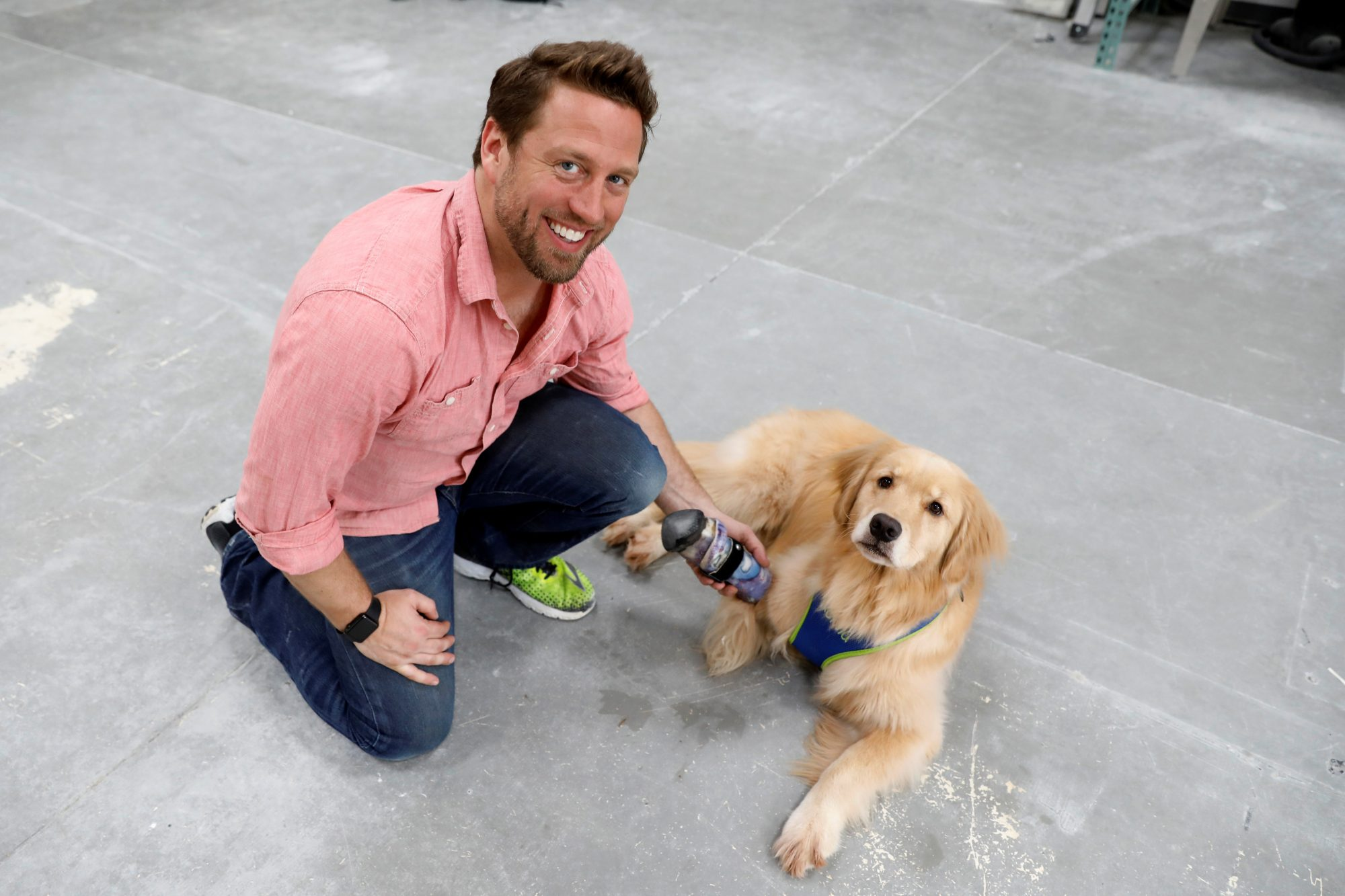 Derrick Campana holds the prosthetic paw he made for Kenna, a three year-old golden retriever born without a front paw. More than 90 percent of Campana's patients are dogs. Photo by Kevin Lamarque/Reuters