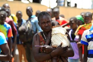 South Sudanese refugee woman, displaced by fighting, holds her child on arrival at Imvepi settlement in Arua district, northern Uganda, April 4, 2017. Picture taken April 4, 2017. REUTERS/James Akena - RTX35467