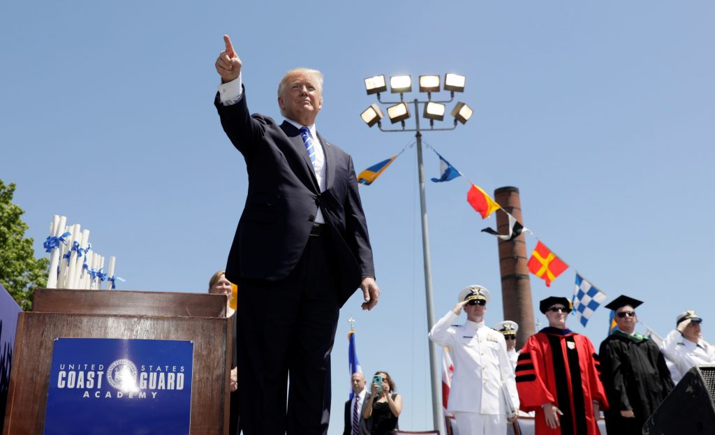 President Donald Trump points to the audience at the conclusion of the United States Coast Guard Academy Commencement Ceremony in New London, Connecticut. Photo by Kevin Lamarque/Reuters