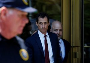 "Former U.S. Congressman Anthony Weiner exits U.S. Federal Court with attorney Arlo Devlin-Brown (back, R), after pleading guilty to one count of sending obscene messages to a minor, ending an investigation into a ""sexting"" scandal that played a role in last year's U.S. presidential election. Photo taken May 19, 2017. Photo by Reuters"