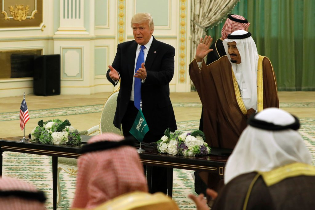 Saudi Arabia's King Salman bin Abdulaziz Al Saud (R) and U.S. President Donald Trump (L) react to applause after signing a joint security agreement at the Royal Court in Riyadh, Saudi Arabia, in May. Photo by Jonathan Ernst/Reuters