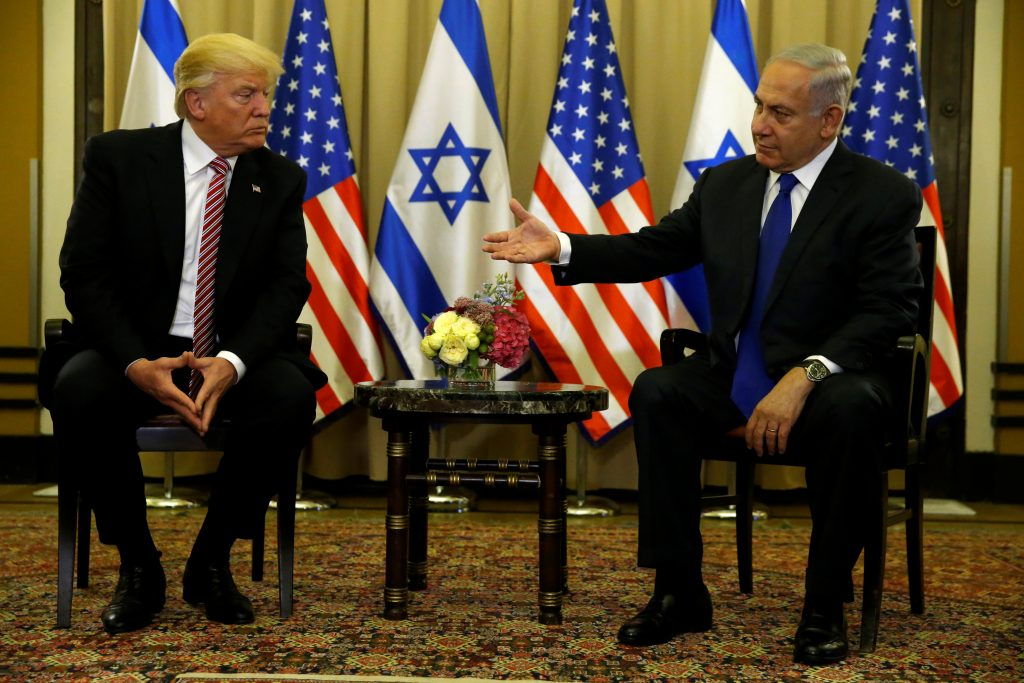 Israel's Prime Minister Benjamin Netanyahu (R) puts his hand out to U.S. President Donald Trump after speaking to reporters before their meeting at the King David Hotel in Jerusalem. Photo by Jonathan Ernst/Reuters