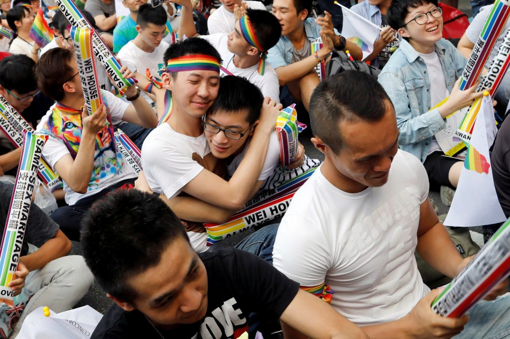Supporters hug each other during a rally after Taiwan's constitutional court ruled that same-sex couples have the right to legally marry, the first such ruling in Asia, in Taipei