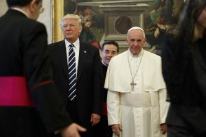 U.S. President Donald Trump stands next to Pope Francis during a private audience at the Vatican