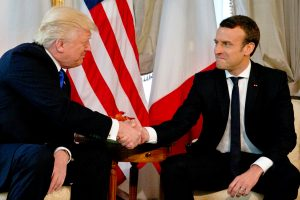 U.S. President Donald Trump (L) shakes hands with French President Emmanuel Macron before a working lunch ahead of a NATO Summit in Brussels, Belgium, May 25, 2017. REUTERS/Peter Dejong/Pool - RTX37KZJ