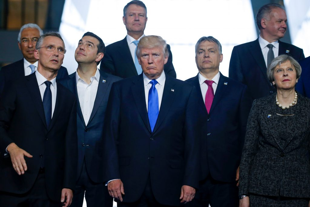 Portuguese PM Costa, NATO Secretary General Stoltenberg, Greek PM Tsipras, U.S. President Trump, Hungarian PM Orban and Britain's PM May pose for a family photo during a NATO summit at their new headquarters in Brussels