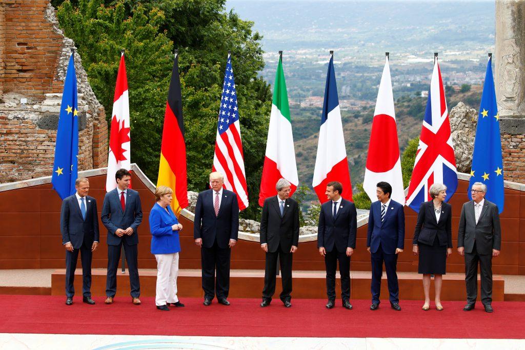 EU President Tusk, Canadian PM Trudeau, German Chancellor Merkel, U.S. President Trump, Italian PM Gentiloni, French President Macron, Japanese PM Abe, Britain's PM May and EU President Jean-Claude Juncker pose in Taormina