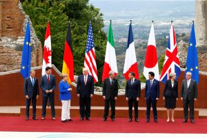 EU President Tusk, Canadian PM Trudeau, German Chancellor Merkel, U.S. President Trump, Italian PM Gentiloni, French President Macron, Japanese PM Abe, Britain's PM May and EU President Jean-Claude Juncker pose in Taormina