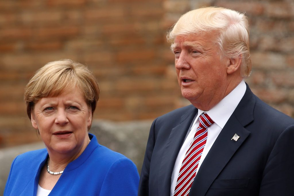 President Donald Trump and German Chancellor Angela Merkel pose for a photo during a 2017 G7 summit in Sicily, Italy. Phot...