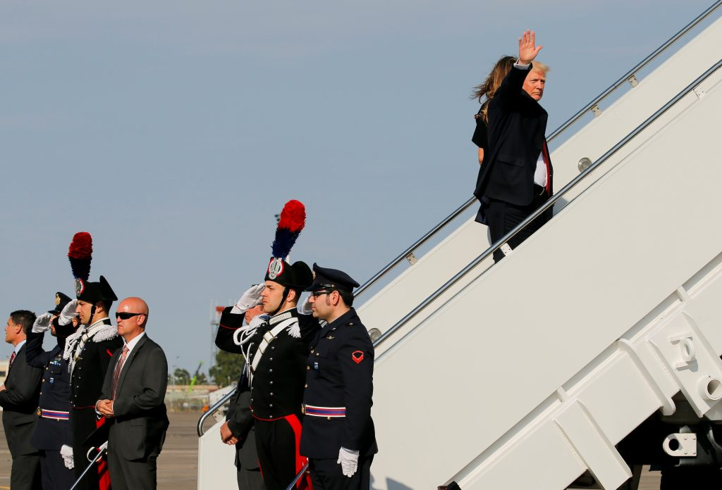 U.S. President Trump waves before boarding Air Force One along with first lady Melania Trump at Sigonella Air Force Base in Sigonella