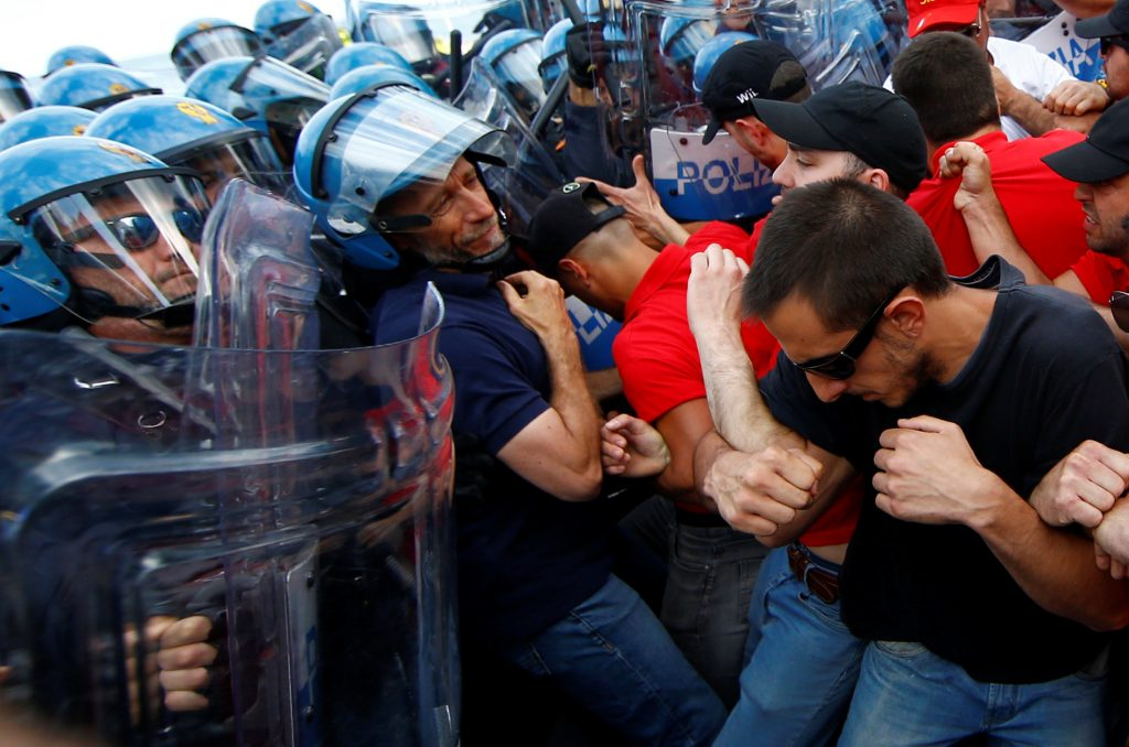 Protesters face police during a demonstration against the G7 summit in Giardini Naxos near Taormina