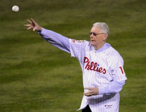 FILE PHOTO - Former Philadelphia Phillies pitcher Jim Bunning throws out the ceremonial first pitch before Game 5 in Philadelphia