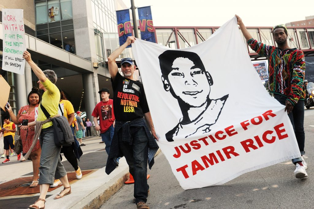 FILE PHOTO -- Jun 9, 2015; Cleveland, OH, USA; Tadar Muhammad (right) and Jeremy Brustein (left) demonstrate in support of Tamir Rice outside of Quicken Loans Arena prior to game three of the NBA Finals. Mandatory Credit: Ken Blaze-USA TODAY Sports/File Photo - RTX389KB