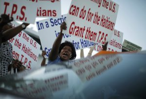 Members of the Haitian community shout slogans in favor of  the Temporary Protected Status (TPS) for Haitian immigrants during a 2009 visit by former President Barack Obama to Miami, Florida. Photo by Carlos Barria/Reuters