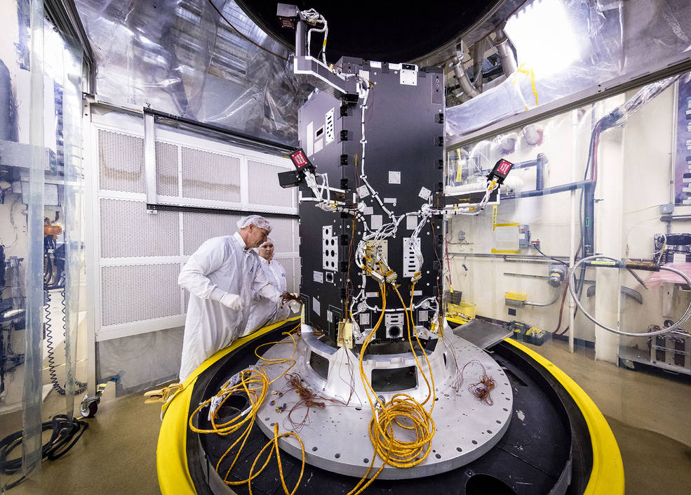 Engineers at the Johns Hopkins University Applied Physics Laboratory in Laurel, Maryland, prepare the developing Solar Probe Plus spacecraft for thermal vacuum tests that simulate conditions in space. Photo by NASA/JHUAPL