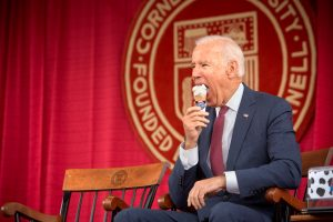 "Former Vice President Joe Biden enjoying his first tastes of ""Big Red, White, and Biden."" Photo courtesy of Cornell University"