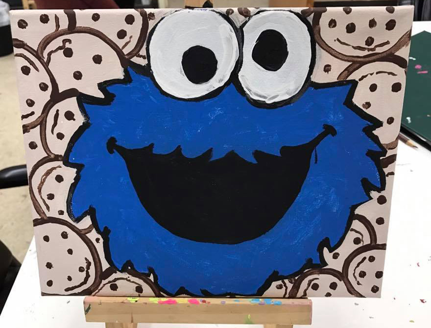 Chris' painting of Cookie Monster has sold, but the artists can commission their work, sometimes adding a twist to keep them unique. Photo courtesy of Garden Center Services